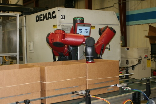 A robot helps automate the packaging and routing process.