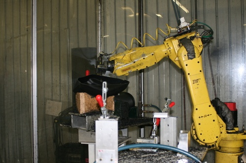 A robotic arm is used to help with machining.